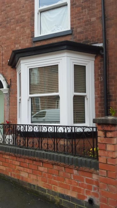 Vertically sliding windows for a traditional styled terraced house